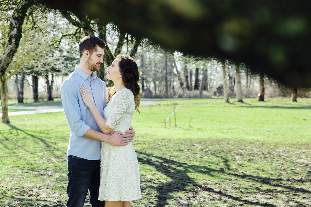 A sunny spring engagement session at Hovander Homestead in Ferndale, Washington. www.mimsicalphotography.com by Christina Voorhorst Couple in orchard looking at each other #bunny #engagement #spring #engagement #truck #country #lace #puddles #mimsicalphotography #romantic #emotion #connection #pose #coupleposes