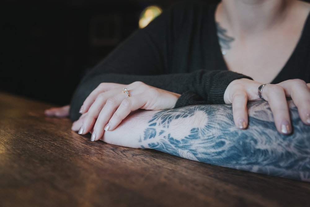 closeup engagement ring hand sleeve tattoo  Casual coffee breakfast engagement session at  TOWNHALL Public House in Langley, BC. By Christina Voorhorst of Mimsical Photography.  #breakfast #engagement #shotglasses #indoors #townhall #langley #britishcolumbia #westcoastphotographer #pub #alehouse #tattoos #coffee #documentary