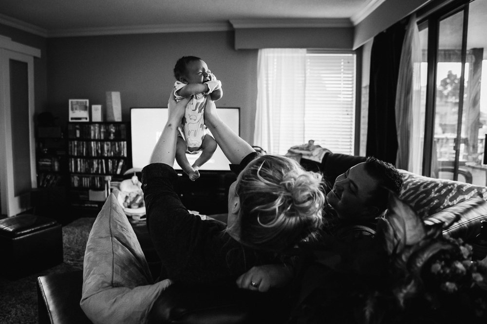 The simba pose - mum lifting new baby up   In home documentary newborn session. Mimsical Photography, White Rock, British Columbia #newborn #lifestyle #documentary #reallife #babyboy #nursery #black #apartment #firstbaby #christmas #newparents