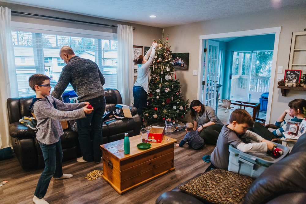In home tree decorating traditions,  Documentary Family Holiday Tradition, Real life moments with a family of 7 by Mimsical Photography. West Coast photographer in Lower Mainland, British Columbia