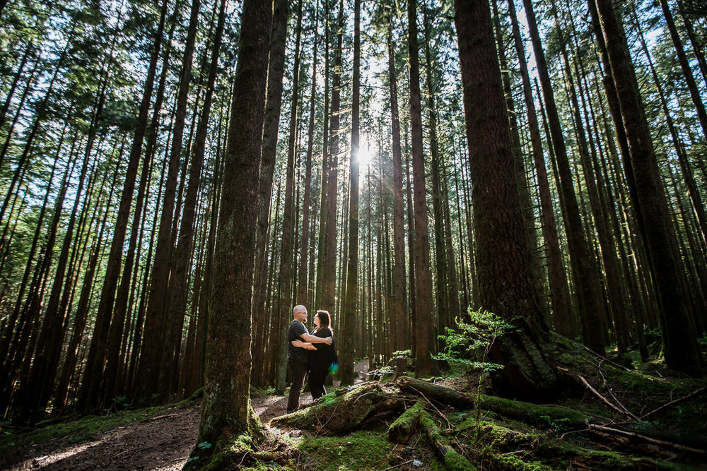couple facing each other close together in a romantic pose in the forest during spring engagement photography at  Spirea Nature Trail in Golden Ears Provincial Park in British Columbia by Mimsical Photography