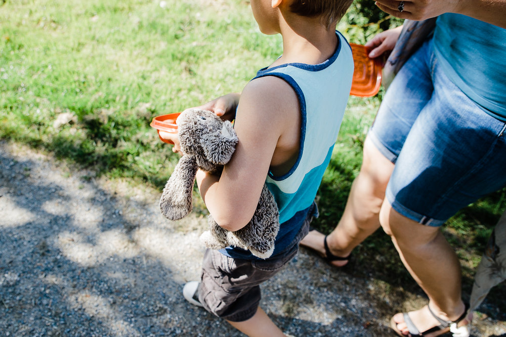 Boy holding stuffed bunny during family walk at aldergrove bowl provincal park fun and candid shots  Vancouver Family Photographer and Engagement Photographer Fraser Valley by Mimsical Photography