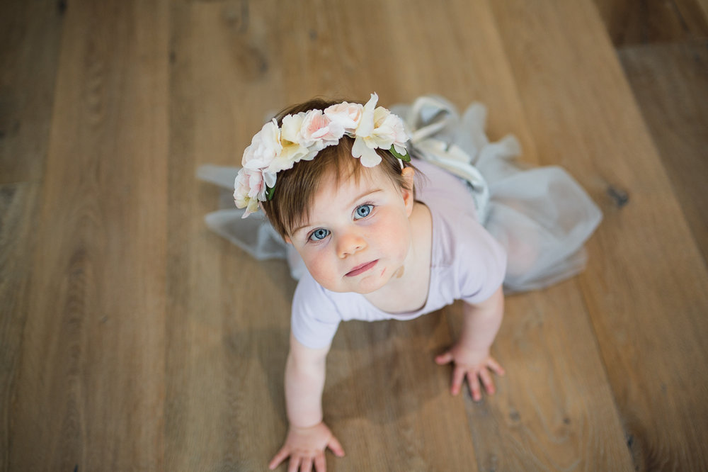 baby flower girl with flower crown on head before outdoor summer wedding at Kwomais Point Park in Ocean Park Surrey British Columbia by Mimsical Photography who is a wedding photographer from Langley, BC that has a candid and documentary fun style.