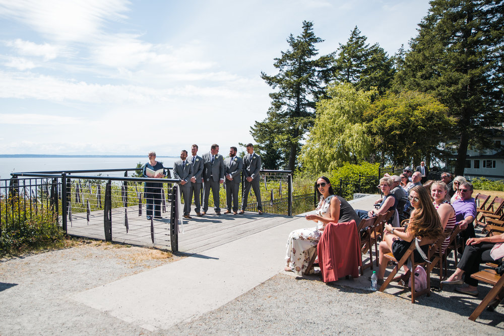 groom and groomsmen waiting for the arrival of the bride during outdoor summer wedding at Kwomais Point Park in Ocean Park Surrey British Columbia by Mimsical Photography who is a wedding photographer from Langley, BC that has a candid and documentary fun style.