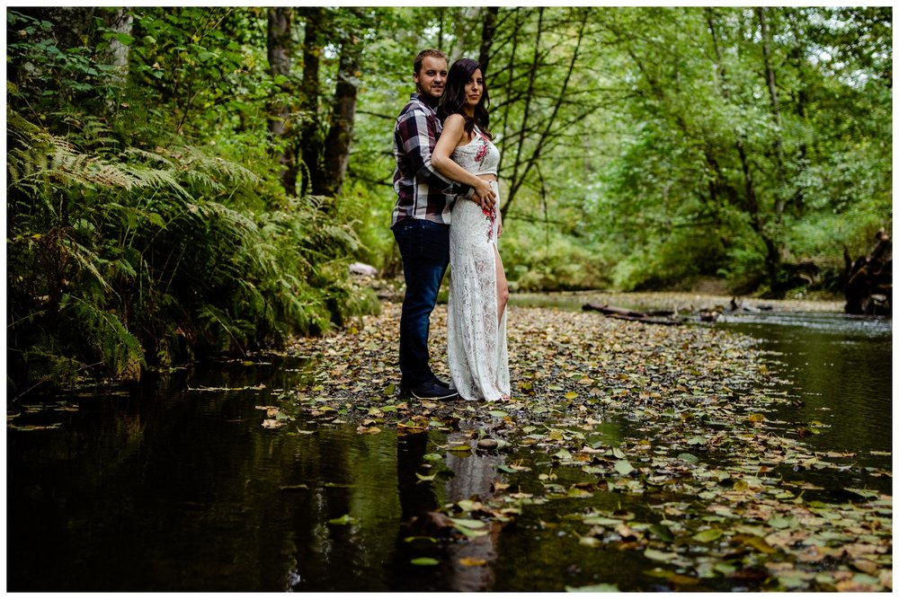 Williams Park Aldergrove Engagement Photographer Moody Fall Couple River Water Romantic Pose Yellow Leaves White Dress Dark_0004.jpg