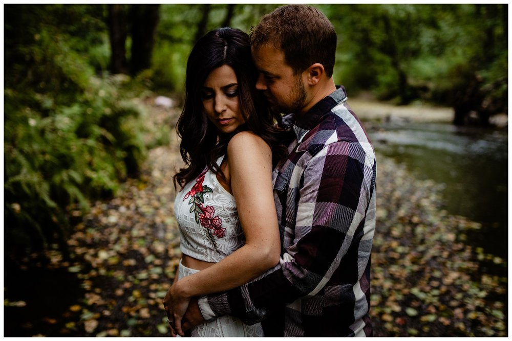 Williams Park Aldergrove Engagement Photographer Moody Fall Couple River Water Romantic Pose Yellow Leaves White Dress Dark_0006.jpg