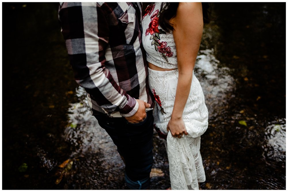 Williams Park Aldergrove Engagement Photographer Moody Fall Couple River Water Romantic Pose Yellow Leaves White Dress Dark_0015.jpg
