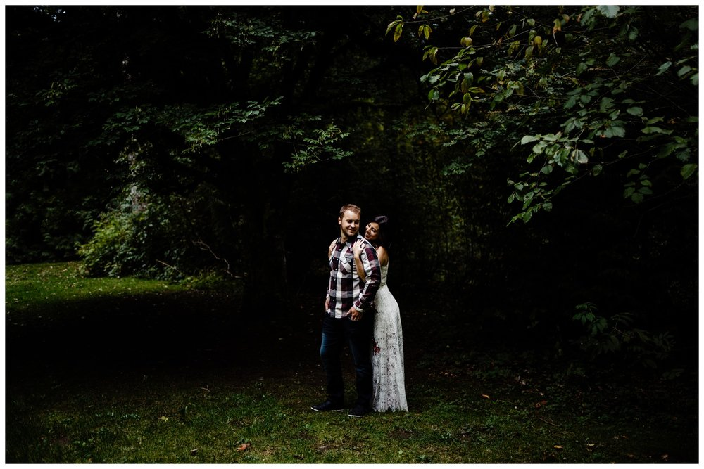 Williams Park Aldergrove Engagement Photographer Moody Fall Couple River Water Romantic Pose Yellow Leaves White Dress Dark_0023.jpg