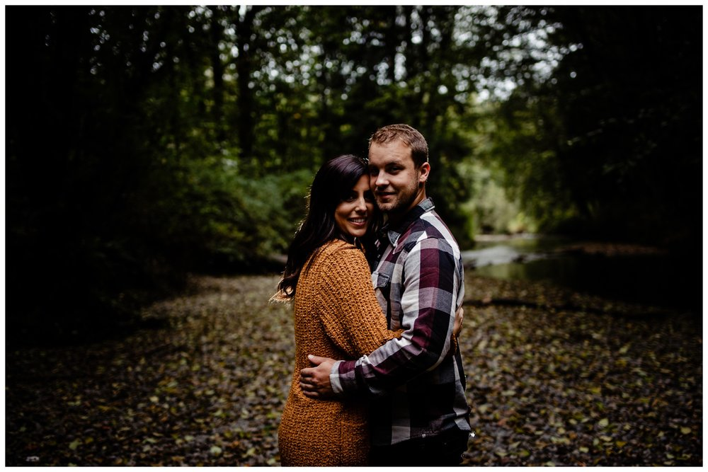 Williams Park Aldergrove Engagement Photographer Moody Fall Couple River Water Romantic Pose Yellow Leaves White Dress Dark_0036.jpg