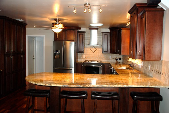 Kitchen Bar with Granite Countertops.