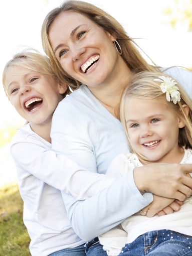 stock-photo-14809964-happy-mom-with-her-two-girls-in-lap.jpg
