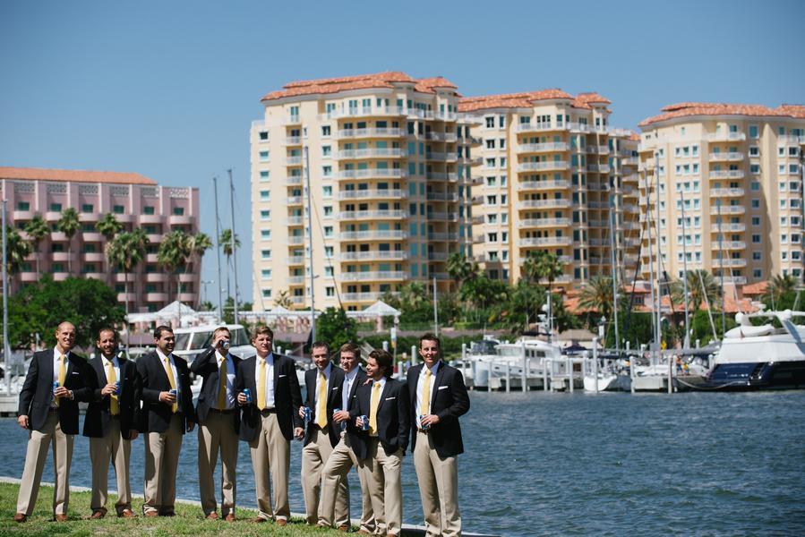 Gentlemen looking smart in navy jackets with khaki slacks