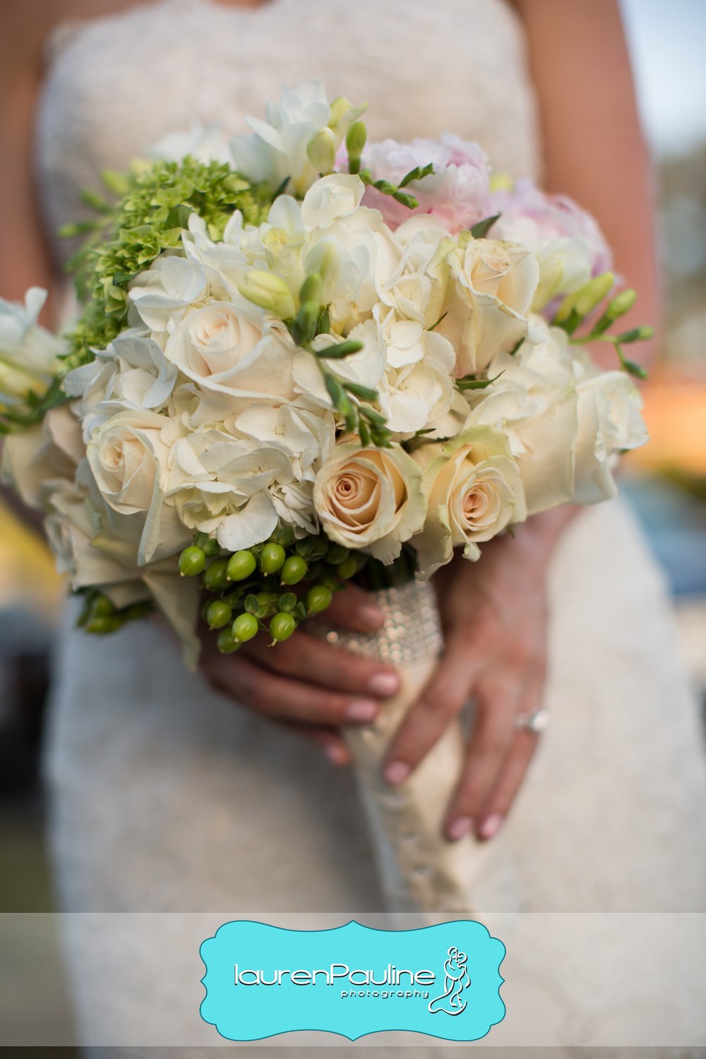 The bride carried a bouquet of hydrangea, roses, peonies, freesia, viburnum, and hypericum berries