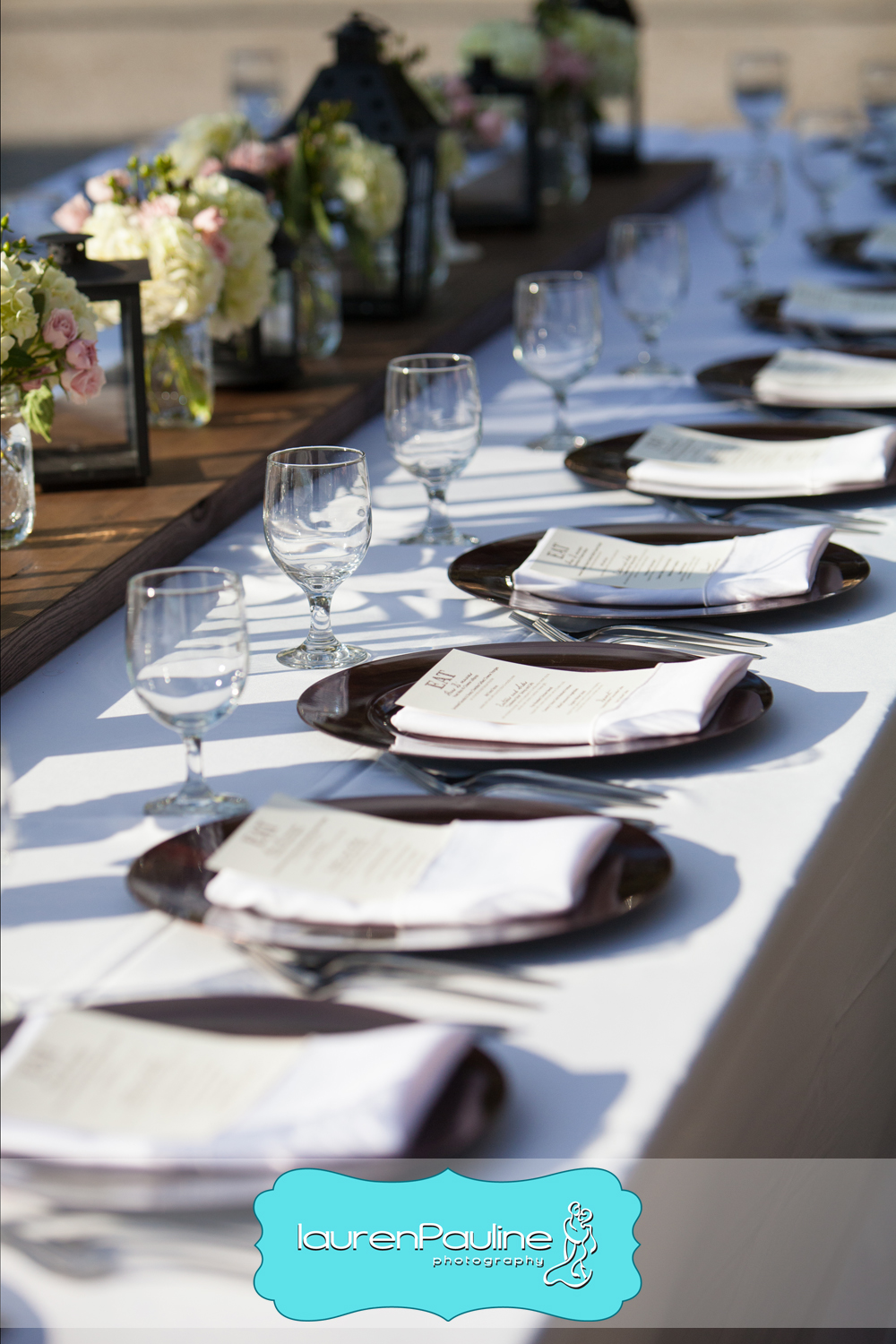 Copper chargers topped with menus lined the feasting tables overlooking the water