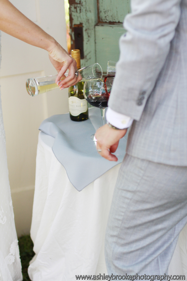 The couple participated in a unity wine ceremony, pouring two wines into one glass from which they both sipped