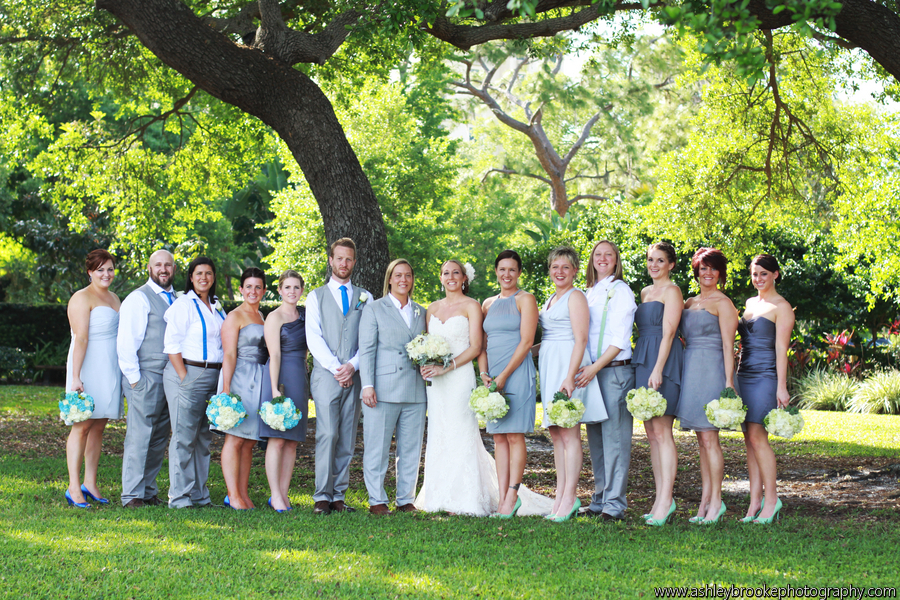 The wedding party wore grey suits and dresses accented with cerulean or sage flowers and accessories