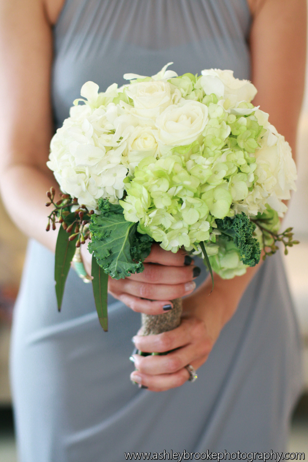 Bridesmaid bouquets featured green and white hydrangea, roses, seeded eucalyptus, and kale leaves