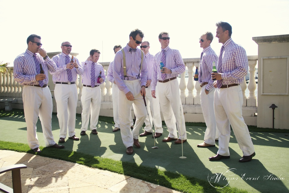 The groomsmen wore khaki pants and gingham shirts with bowties.