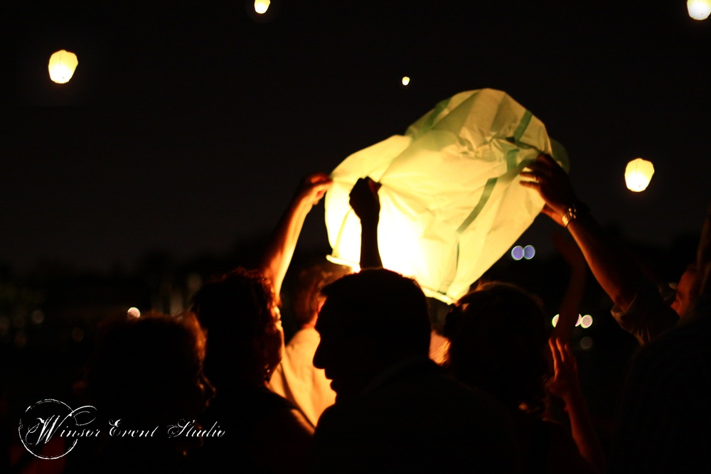 At the end of the evening, guests sent sky lanterns into the night sky as a unique send off for the couple.