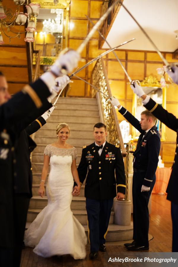 The couple made their grand entrance into the reception under an arch of sabers