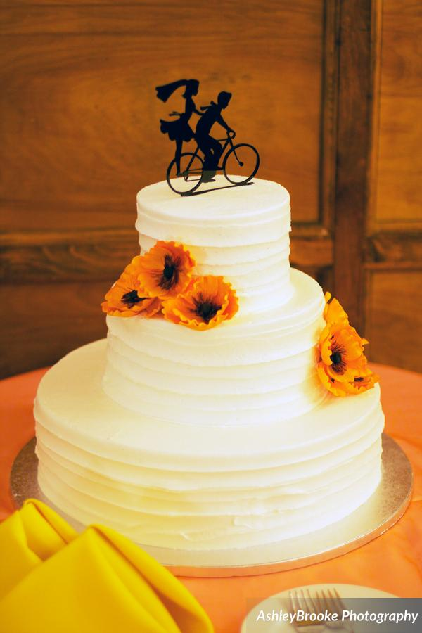 The wedding cake was adorned with sugar poppies and a whimsical cake topper
