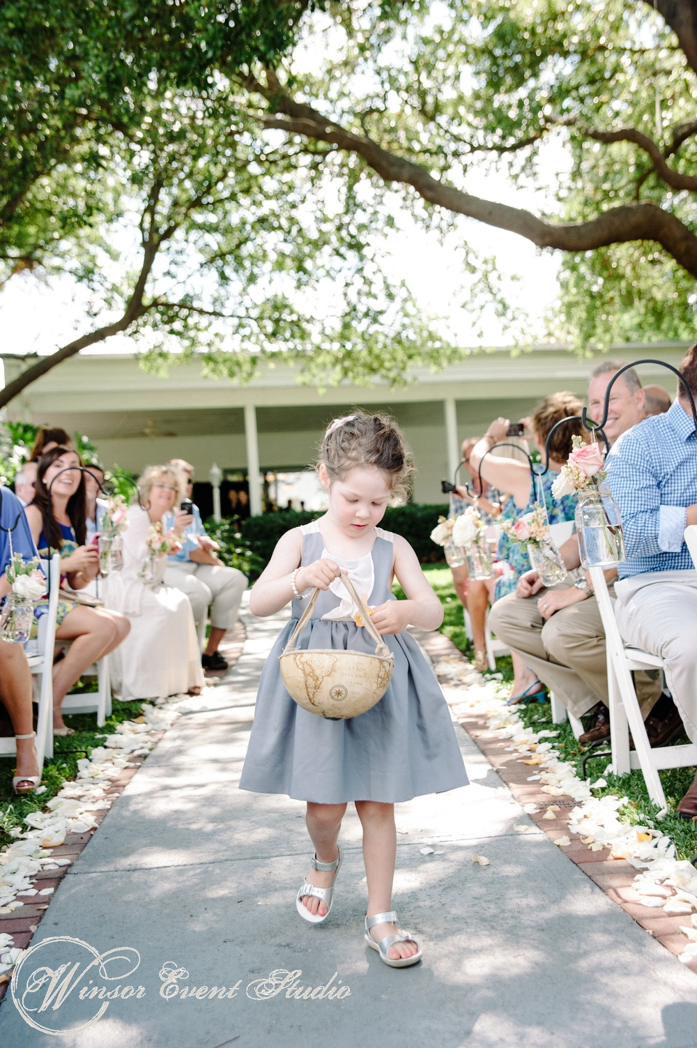 The flower girl carried petals in a handmade globe basket
