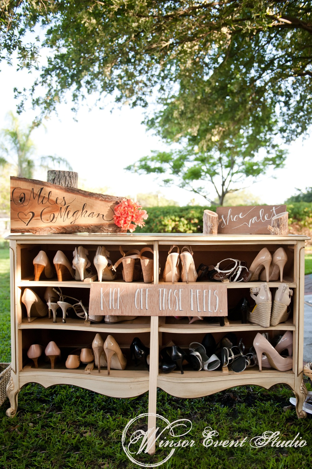 A vintage dresser 'shoe valet' invited guests to kick off their heels and grab a pair of flip flops