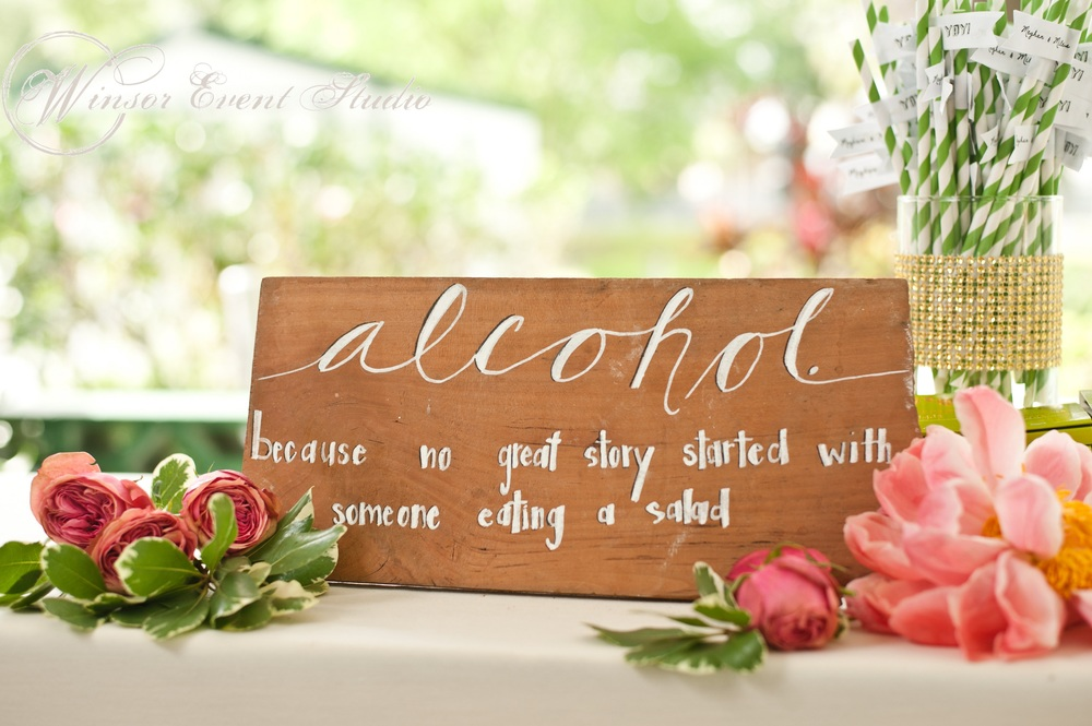 The bride DIYed many details like the wood signage and flagged beverage straws