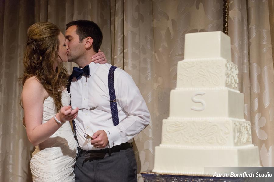 The five-tier square wedding cake was adorned with piped buttercream and the couple's monogram