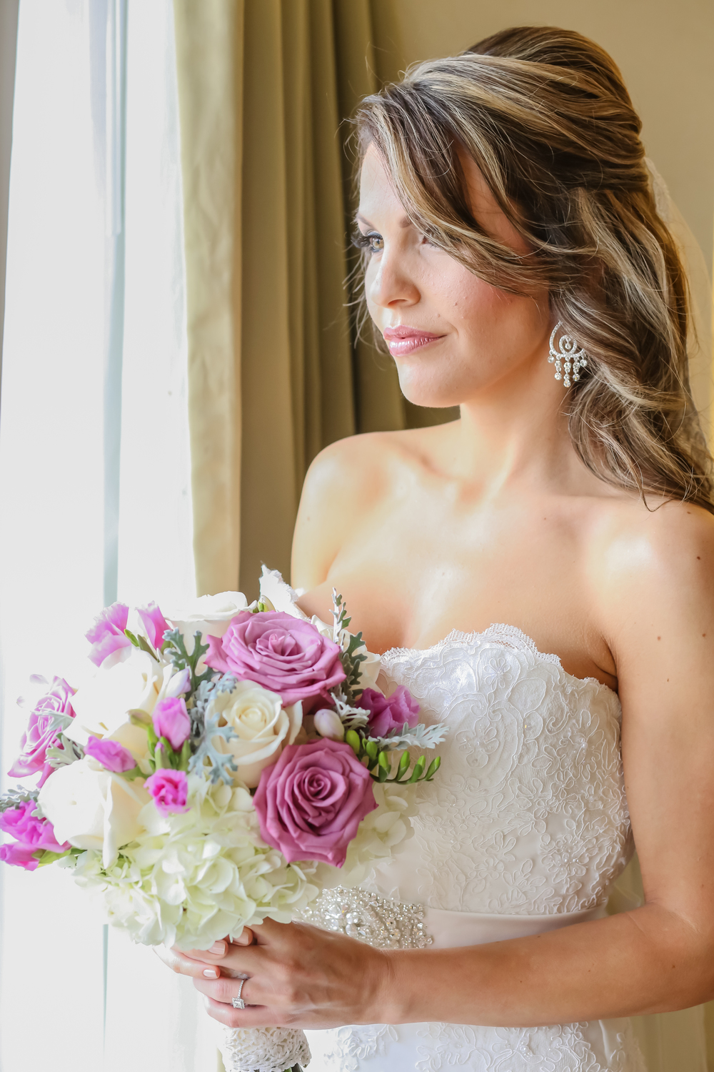 This stunning bridal bouquet consisted of hydrangea, roses, freesia, dusty miller and lisianthus.