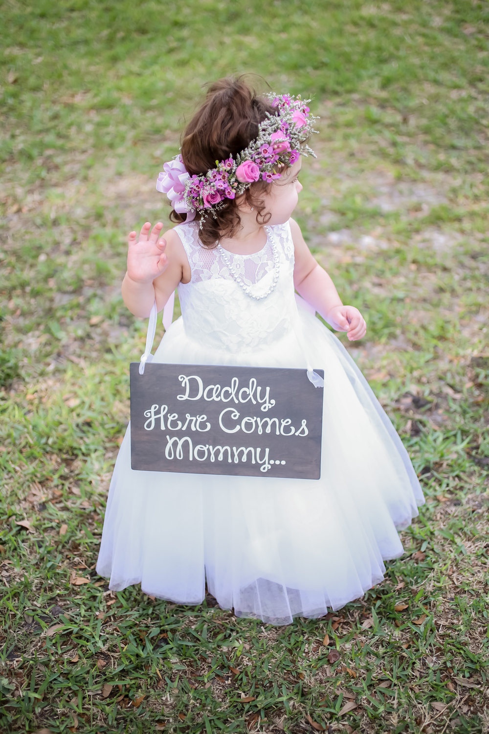 How adorable is this flower girl and her sign and floral crown?