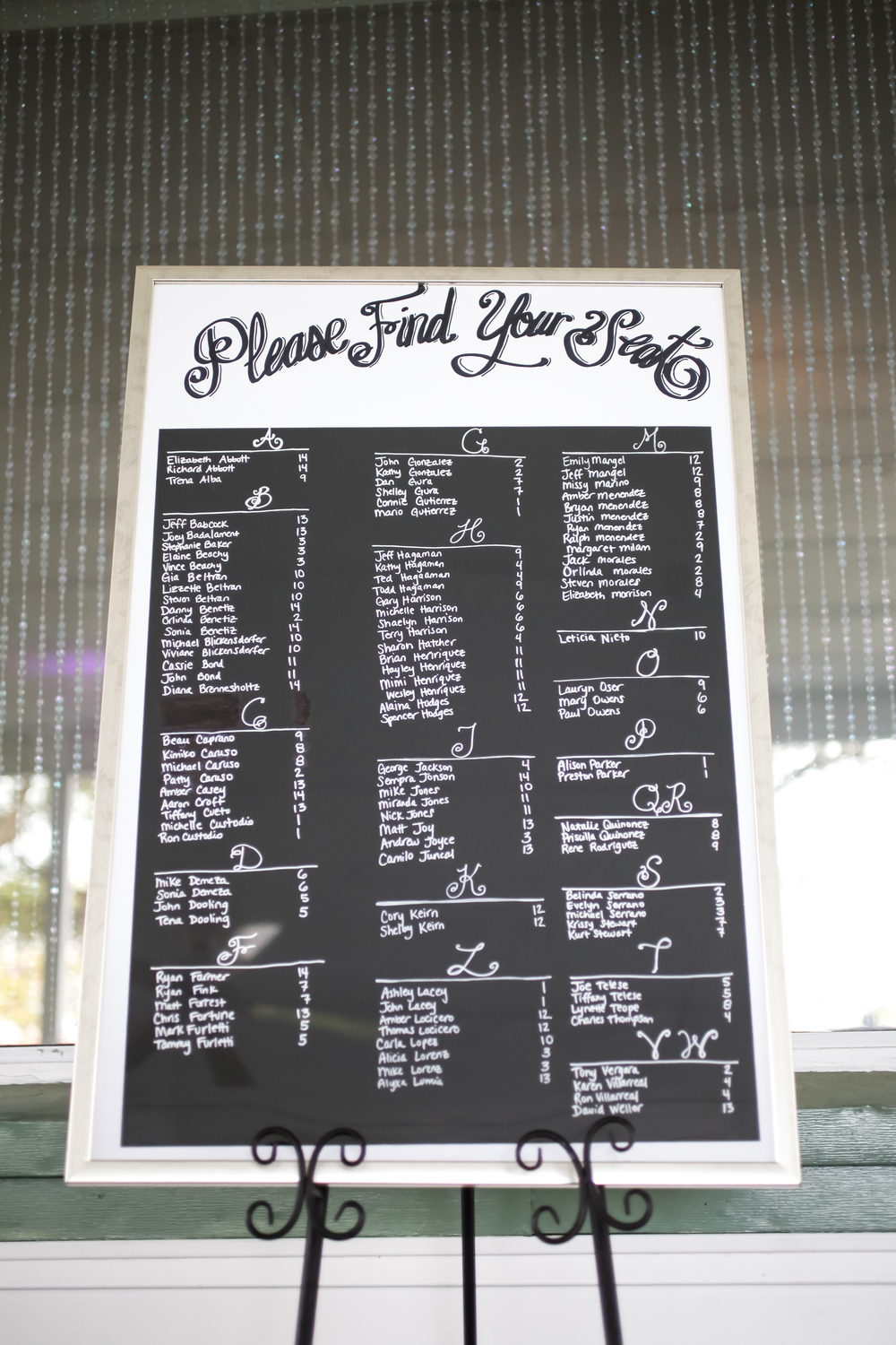 The chalkboard-style seating chart stylishly directed guests to their reception tables.