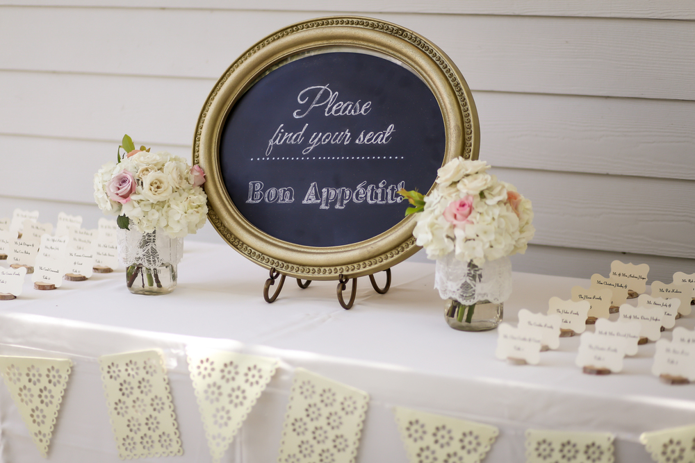 Lace-trimmed escort cards looked oh so adorable displayed on miniature cut wood slabs