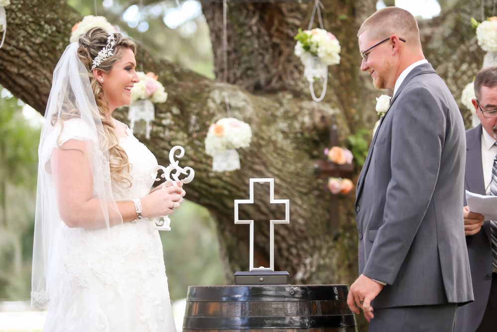 The bride and groom partook in a unity cross ceremony, symbolizing their marriage