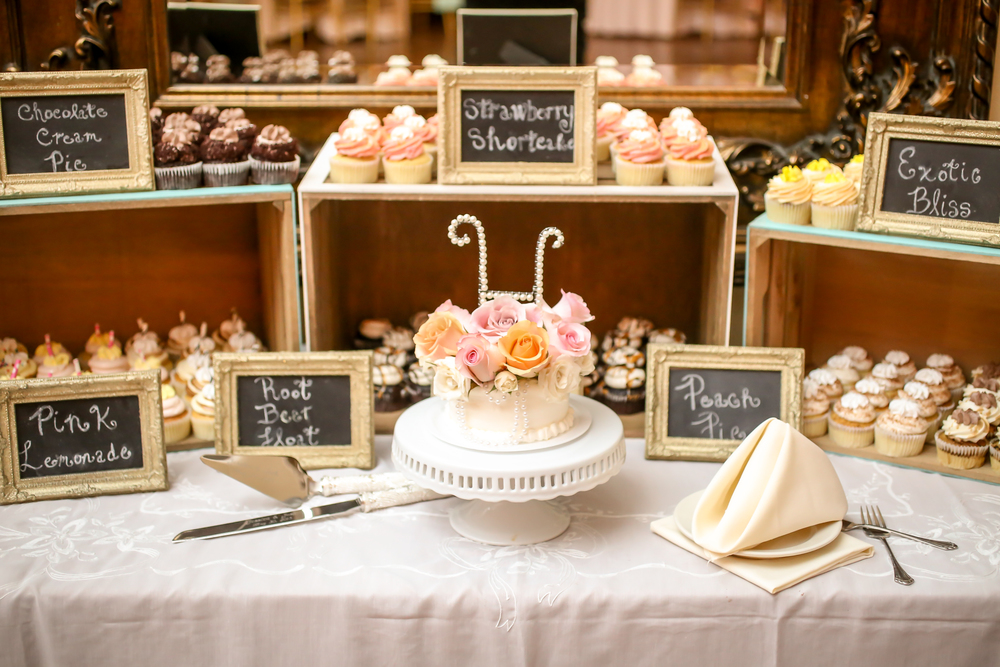 Wooden crates, vintage frames, and an ornate cake stand created the perfect cupcake display