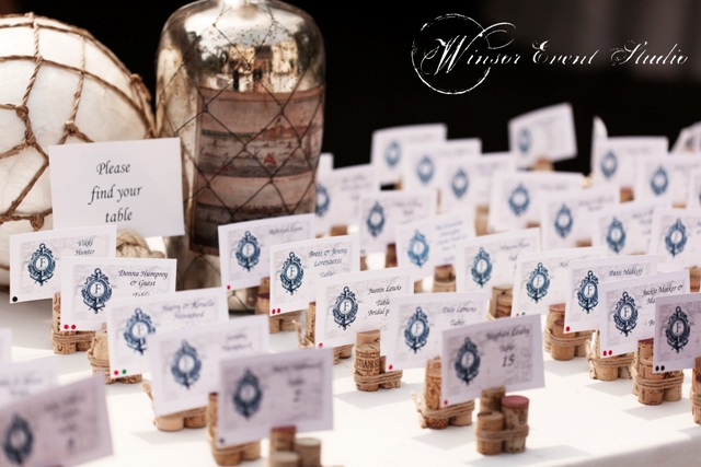 The escort cards echoed the nautical theme, resembling rows of tiny pier markers tied with rope