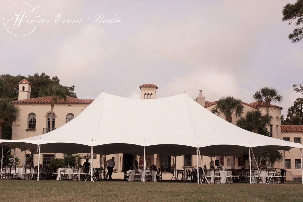 A high peak tent offered shade and unobstructed views of the water from the reception tables