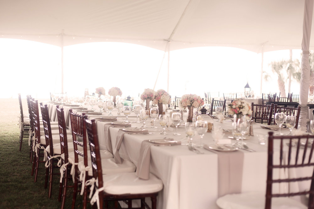 A large feasting table for the wedding party was lined with candles and bouquets