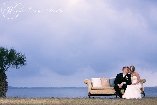 The bride & groom posed for a sweet photo on one of the vintage sofas that surrounded the dance floor