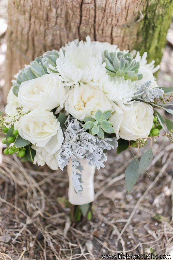 The bride's bouquet featured hydrangea, garden roses, mums, succulents, dusty miller, eucalyptus, &berries.