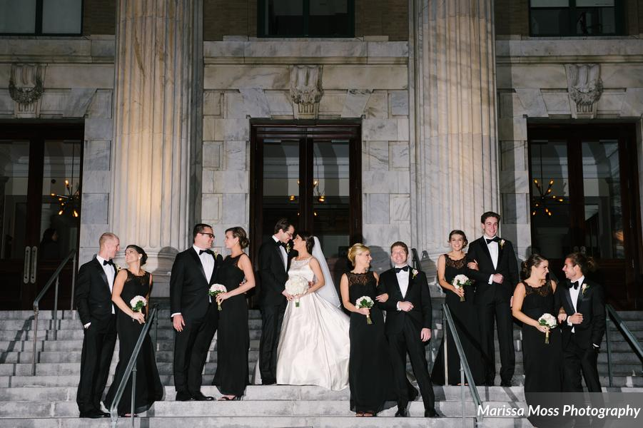 The wedding party posed for photos on the steps of the historic Vault building