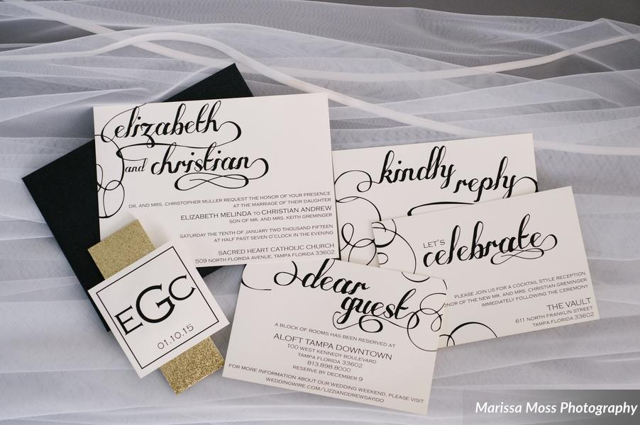The stationery, created by the groom's sister, featured a black and white calligraphy design