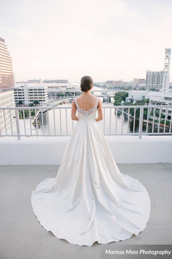 The bride looked stunning in her ballgown with rhinestone illusion neckline and chic chignon