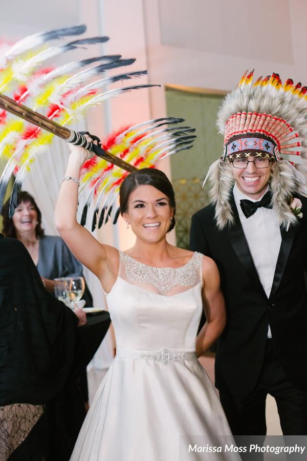 The FSU-loving bride and groom sported Seminole headdress and spear for their introduction