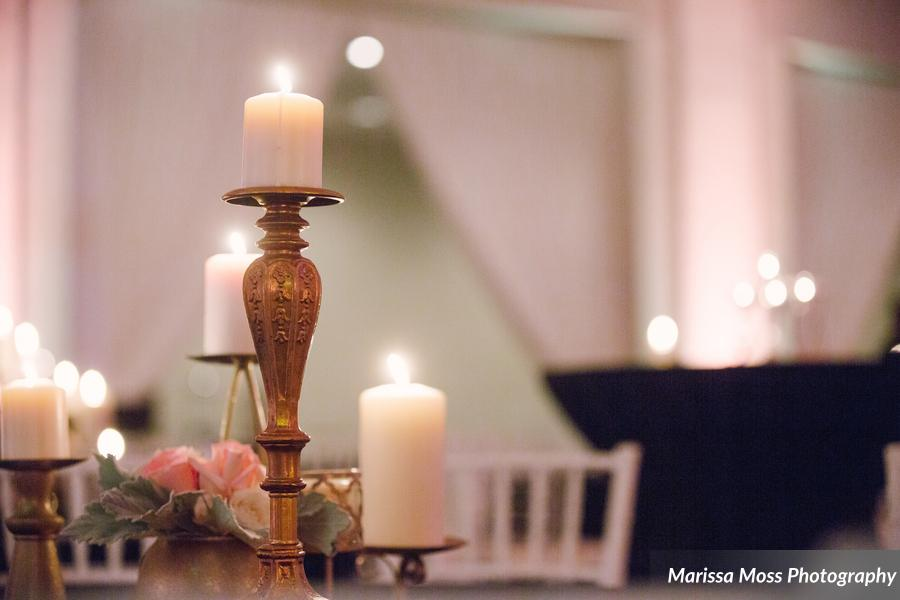 Clusters of assorted gold candles created ambient lighting throughout the reception