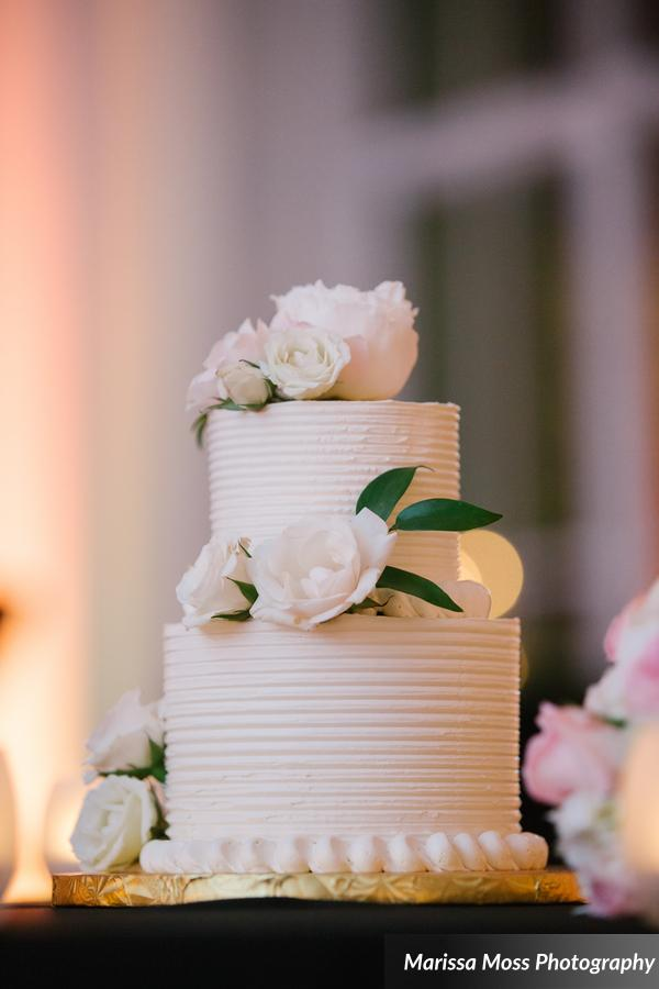 With such an abundance of sweets on display, the couple ceremoniously cut a simple petite cake