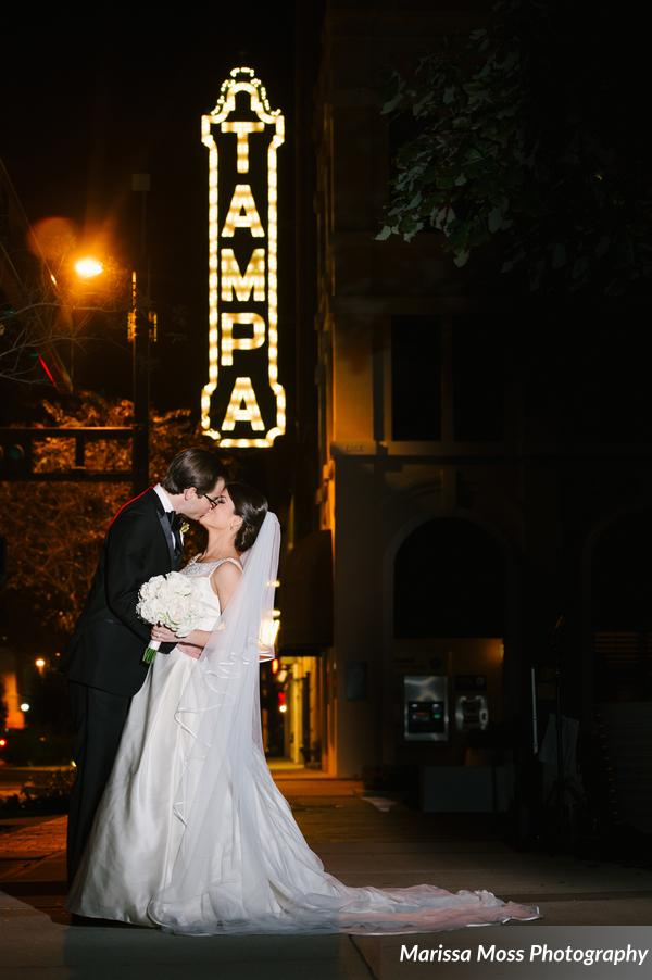 The bride and groom posed for a photo in front of the historic Tampa Theater downtown