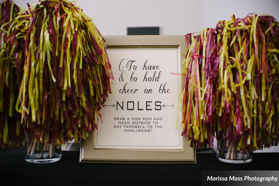 Guests cheered on the bride and groom (and the 'Noles) with a pom pom send off at the end of the night