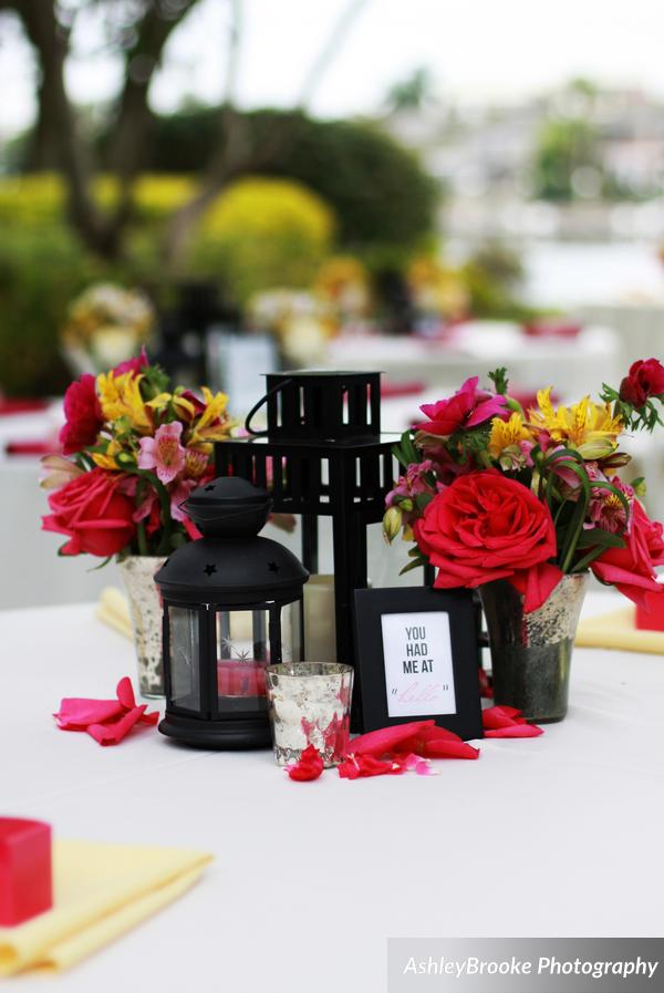 A trio of lanterns paired with mercury glass votives and vases made for colorful centerpieces