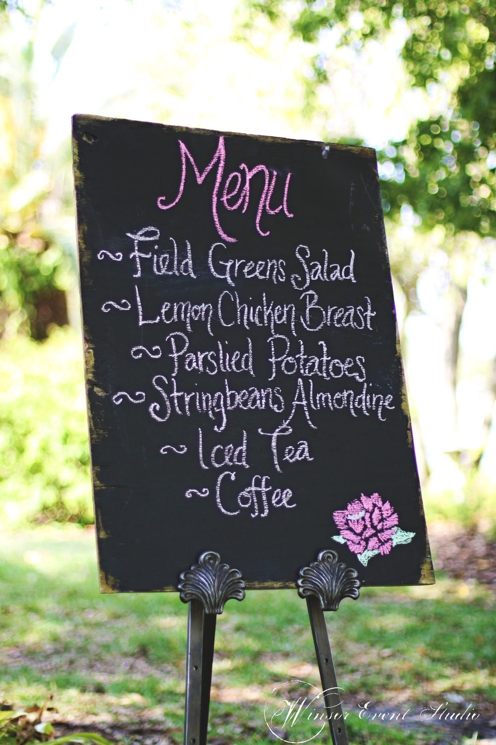 The couple's Southern homestyle dinner menu was handwritten on a chalkboard and easel